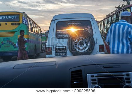 Dhaka, bangladesh, august 2017- the sun is comming though a car's back window and reflected on car's front which is position behind it taken at Dhaka, bangladesh, on August 17, 2017.