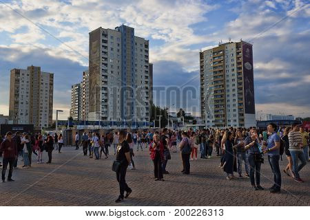 KHARKIV UKRAINE - JUNE 6 2016: People in the square at the Metallist stadium in Kharkov and on the background of newly-built houses
