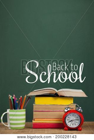 Digital composite of Books on the table against green blackboard with back to school text