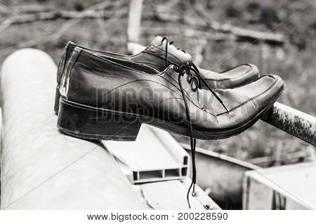 Old black men shoes like symbol of time and past at black and white
