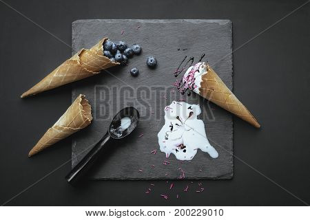 Ice Cream And Blueberries In Wafer Cones