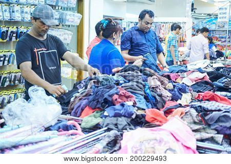 Dhaka, bangladesh, august 2017- poeple are shopping cloths and shoes at local cheap shopping center for thie comming holidays located at boshundhora shopping market in dhaka in bangladesh taken on 17 august 2017.