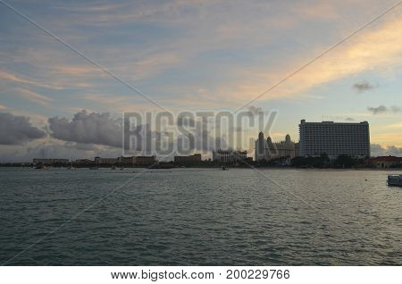 Silhouetted high rise hotels with the setting sun in Aruba.