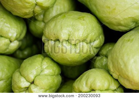 Close up chayote (Sechium edule) fruit background look like a group of monster head