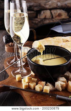 Gourmet Swiss Fondue Dinner On A Winter Evening With Assorted Ch
