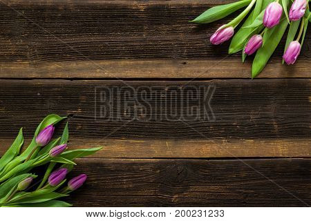Pink Tulips Flowers on rustic table for March 8 International Womens Day Birthday Valentines Day or Mothers day - Closeup