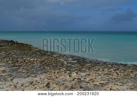 Coastal tide coming over the lava rock in Aruba.