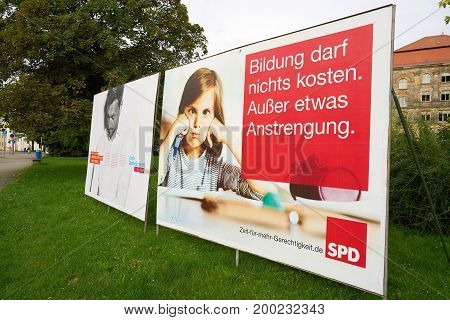 MAGDEBURG, GERMANY - AUGUST 18, 2017: Election campaign posters of different parties, for the Bundestag election on 24 September 2017 in the city center of Magdeburg