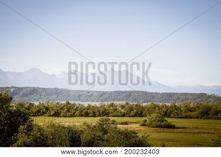 A Beautiful Slovakian Landscape With Tatra Mountains In Background