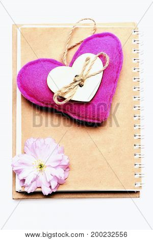 Heart In Pink Colour And Pink Sakura Flower On Notepad