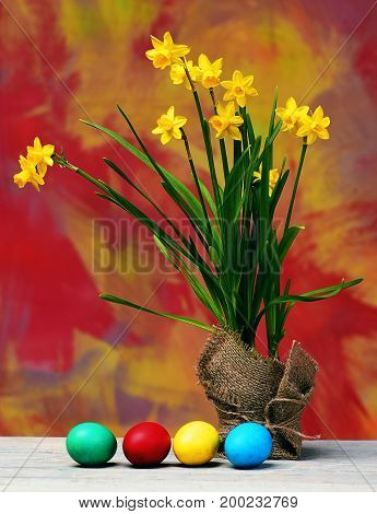Spring Yellow Narcissus And Colorful Easter Eggs