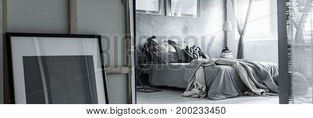 Grey Bedroom With Mess On Bed