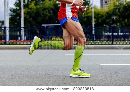 feet athlete man running city marathon in compression socks