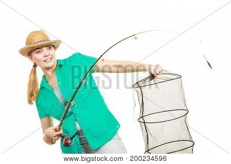 Fishery spinning equipment angling sport and activity concept. Happy smiling woman with fishing rod and net.