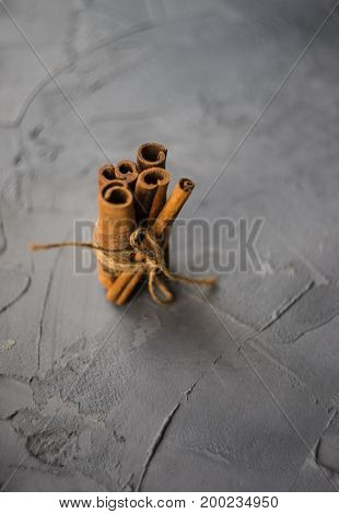 Cinnamon Sticks On Cement Background
