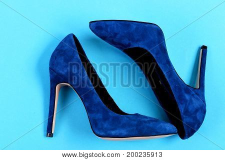 Elegant Blue Suede Shoes Isolated On Blue Background
