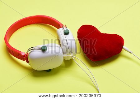 Leisure, Music And Love Concept. Headphones In White And Red