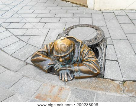 BRATISLAVA SLOVAKIA - OCTOBER 25 2015:The plumber Monument in the center of old town - Bronze statue of Cumil the Peeper