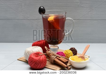 Drinks And Celebration Concept: Mulled Wine, Honey And Cinnamon