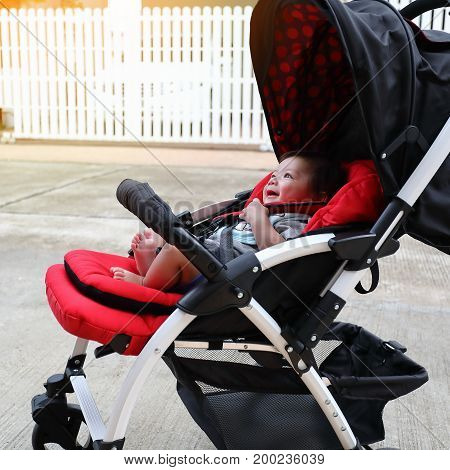Cute Baby Boy Laughing Happy In Child Stroller