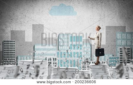 Business woman in suit standing among flying letters with sketched cityscape view on background. Mixed media.
