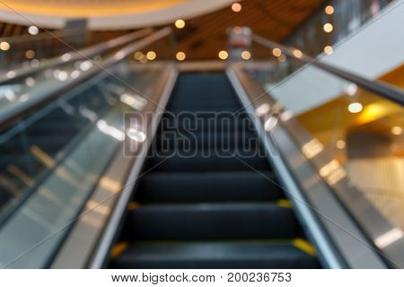 Abstract Blur Luxury Escalator Lift In Business Shopping Mall Building