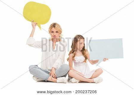 upset mother and preteen daughter holding colorful blank cards isolated on white