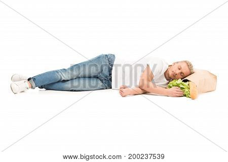 Man Sleeping On Paper Bag With Food