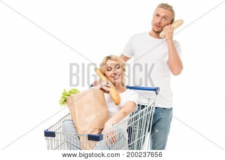 couple pretending talking on telephone with bread isolated on white