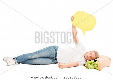 man with blank banner in hand lying on paper bag with food isolated on white