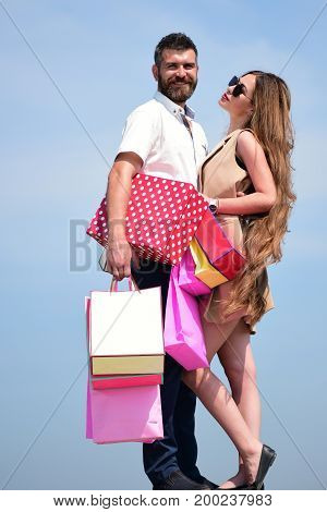 Shopping And Love Concept. Man And Long Haired Woman