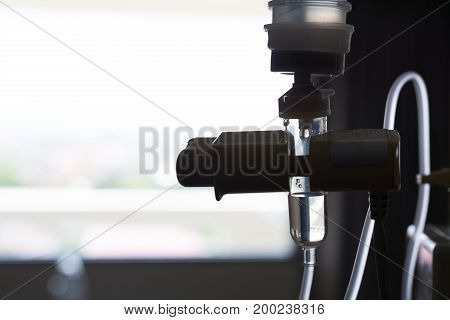 Medical Infusion Iv Drip Saline Solution Bottle In Patient Room Hospital