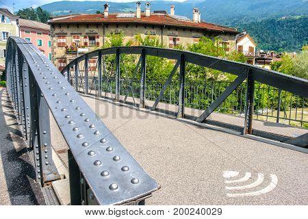 public wifi bridge in Bressanone rivet bridge with wifi symbol on the ground