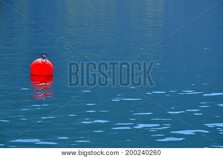 red Buoy for a boat on the left