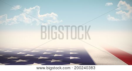 Digitally generated american national flag against blue sky