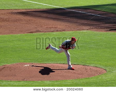 Philles Cole Hamels Steps Though Pitch Lifting Back Leg Into The Air