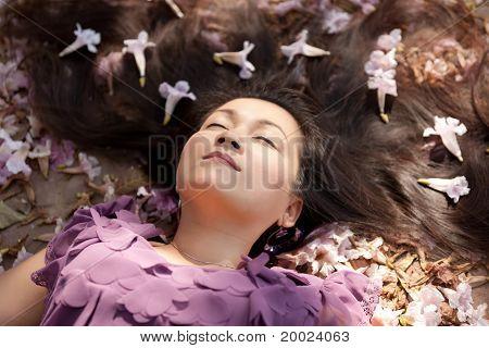 Woman Lying In Flowers