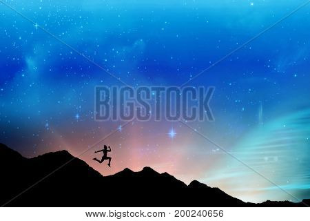 Fit brunette running and jumping against graphic image of illuminated lights