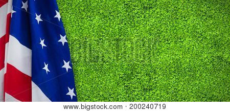 Close-up of star shapes on American flag against close-up of grass mat