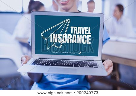 Digital composite of Woman holding a computer with travel insurance concept on screen