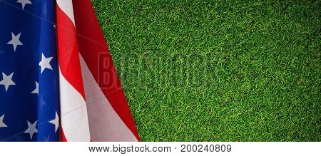 Close up of American flag against close-up of grass mat