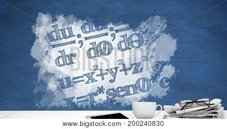 Digital composite of Desk foreground with blackboard graphics of math equations