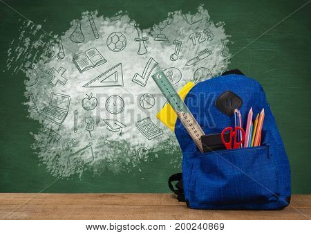 Digital composite of Schoolbag on Desk foreground with blackboard graphics of education icons drawings