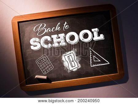 Digital composite of Back to school text on blackboard with chalk and stationery