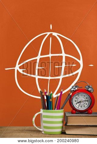Digital composite of Books on the table against orange blackboard with education and school graphics