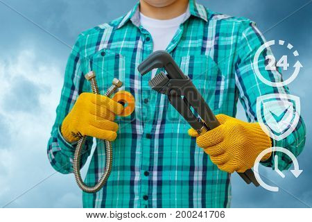 Plumber With Tool In Hands.
