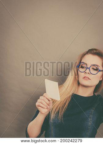 Thinking Woman Wearing Eyeglasses Holding Note