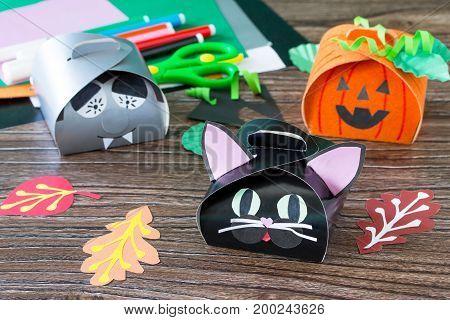 The Child Creates A Gift Box Of The Black Cat Of Halloween. Glue, Scissors, Leaves Of Velvet Paper O