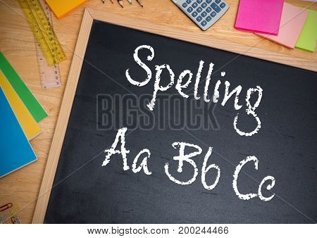 Digital composite of Hand writing Spelling text on blackboard