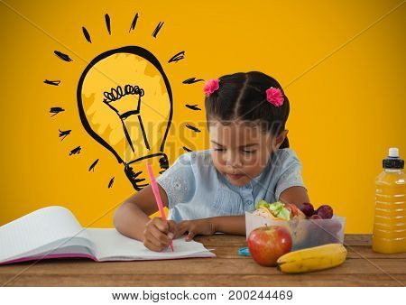 Digital composite of Schoolgirl writing at desk with lunch and light bulb graphic
